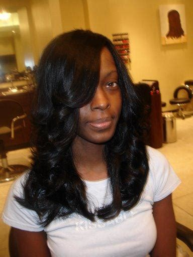 pictures of black hair weave styles feathered curled black weave hairstyles