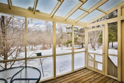 enclosed sun porch  plexiglass roof  screened walls