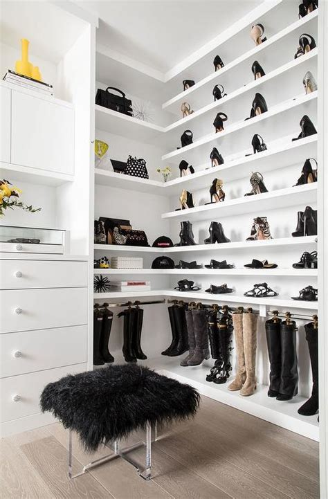 walk in closet with wraparound shoe shelves and hanging