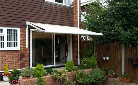 electric awning replaces  manual awning