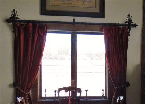 victorian iron curtain rod corbels  ornate scrolls