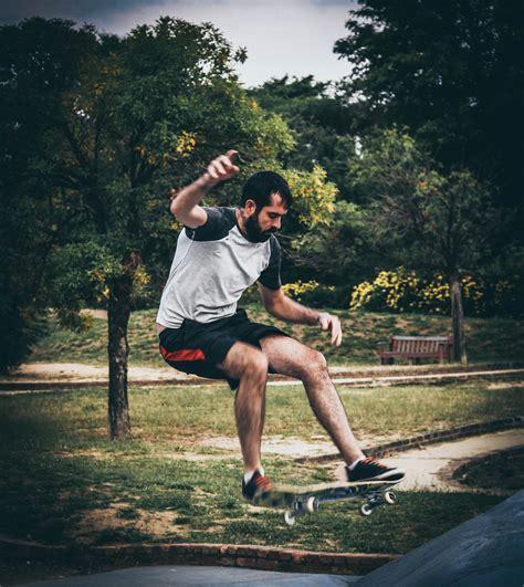 woman riding  skateboard outdoor  stock photo