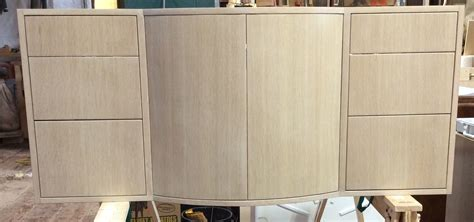 custom floating whitewashed oak vanity  curved doors