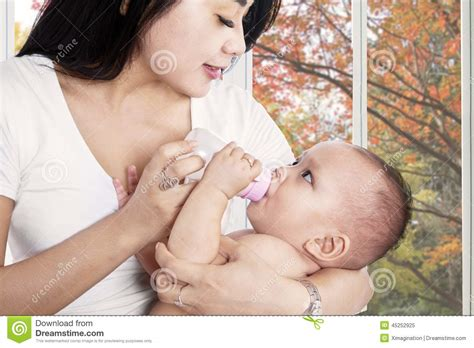Asian Mother Feeding Her Baby Girl Stock Image Image Of