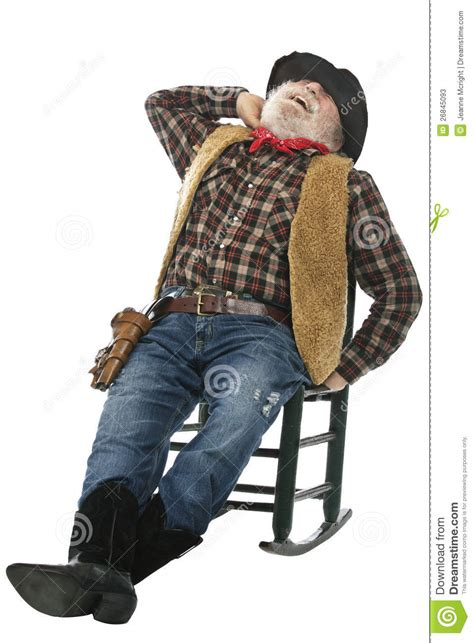 laughing  cowboy stretches  rocking chair stock image
