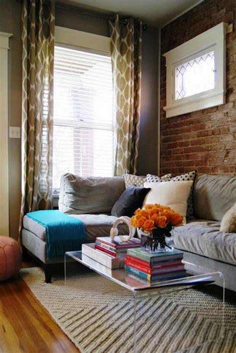 elegant living room  exposed brick wall