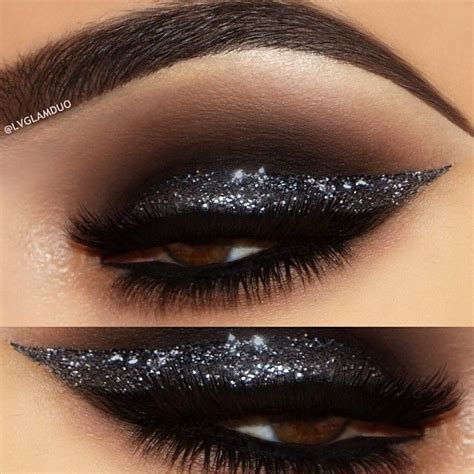 black smokey eye   thick silver glitter liner atlou
