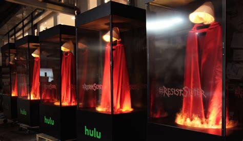 red oppressive smocks worn handmaids tale flames