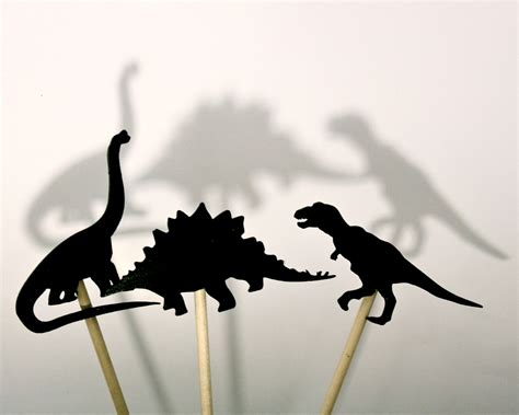 set of 8 wooden dinosaur shadow puppets by jdbmercantile