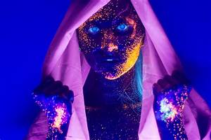 Model Painted With Glowing Makeup Lights Up Beautifully ...