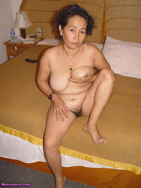 big tits horny asian granny slut spreads and fingers her