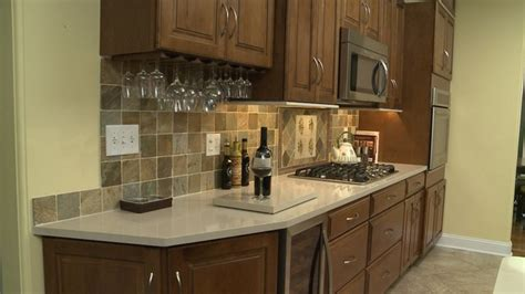 picture of kitchen cabinet merillat masterpiece maple cognac traditional kitchen 4188