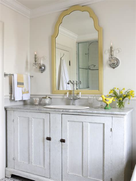 this traditional white bathroom features a gold trim