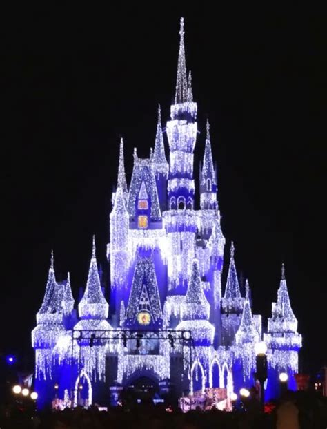 cinderella castle lights at magic kingdom in walt