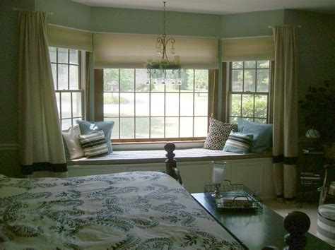 bedroom bay window ideas remarkable brown bedroom bay window design idea with cream curtains and blue white black throw