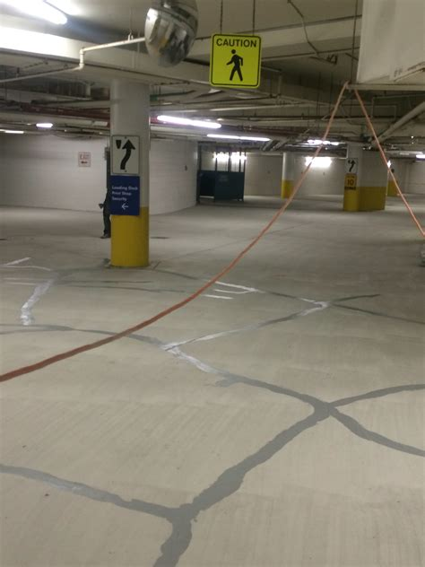 epoxy flooring new york york region center receives new epoxy floor in parking garage epoxyguys