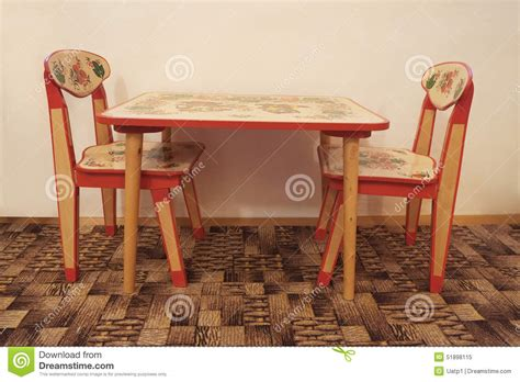 small wooden table and two chairs stock photo image