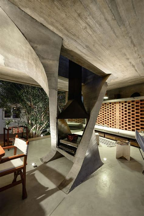 sculptural twisted concrete columns shaping  modern