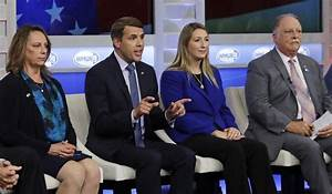 Chris Pappas, second from left, gestures during a debate ...