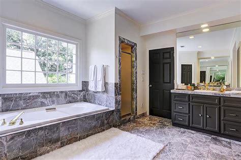 black bathroom vanity  black marble tub contemporary