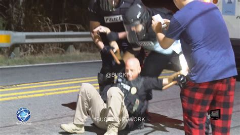 Police Officer Gets Hit In The Head With A Brick during ...