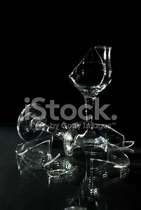 Broken Wine Glasses With Reflection on A Glass Table ...