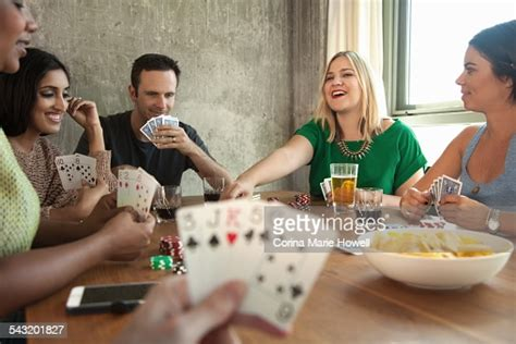 group  friends playing cards  table high res stock