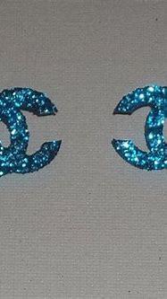 Blue Glitter Chanel Logo Earrings by radicalrecycle ...