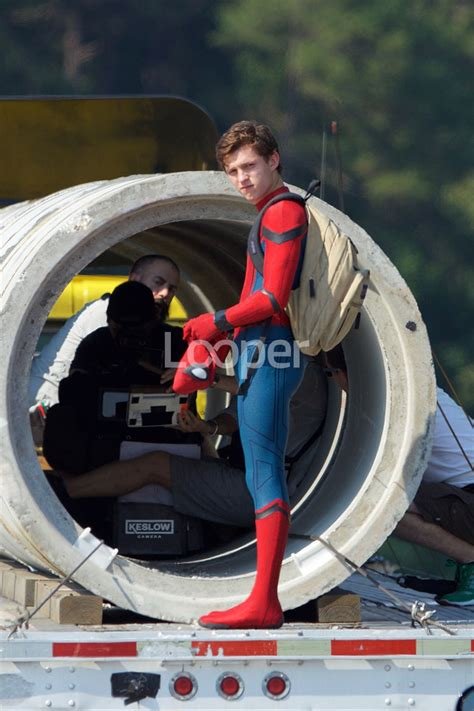 set  show tom holland  spidey suit  spiderman