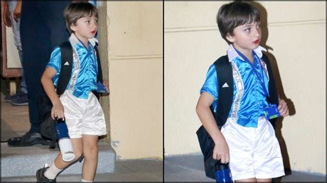 Shahrukh and gauri khan's son abram khan has surely got the looks. Cute Alert! AbRam Khan happily poses with Shah Rukh Khan, wears red lipstick for his dance ...