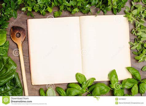 cuisine schmidt green herbs as frame around a cookbook stock image image