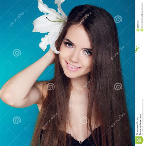 Beautiful Woman With Long Brown Hair And White Flower