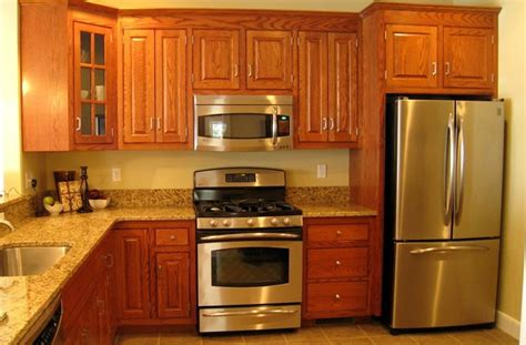 granite with golden oak cabinets kitchen has