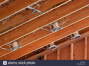 Lighting, Cans, And, Wiring, Installed, In, The, Rafters, Of, A, Vaulted, Stock, Photo