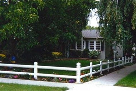 2 Rail And White Picket Fence In Front Yard