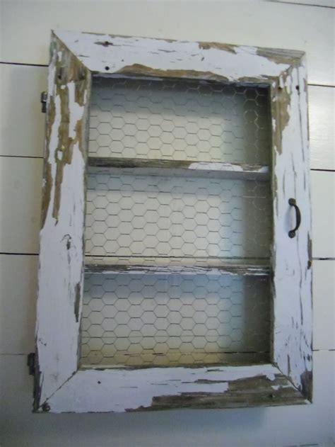 Chicken wire shelf/cabinet   window .. door, porch post