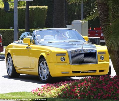 yellow rolls royce scott disick has some alone time as he cruises around in