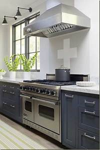 Yellow color accents jazz up elegant dark gray kitchen for Kitchen colors with white cabinets with jazz metal wall art