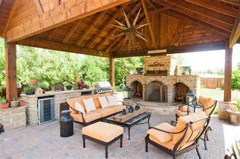 backyard entertainment outdoor entertainment area with fireplace and covering