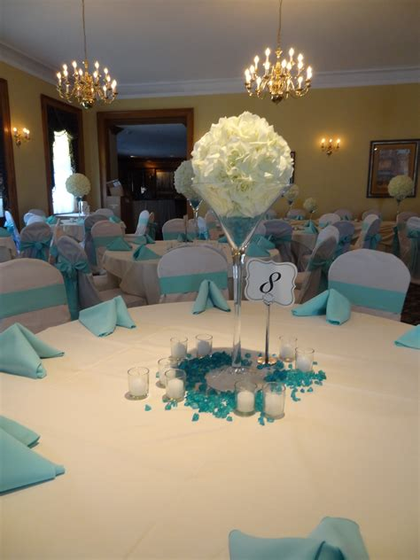 blue and white table centerpieces oversize martini glasses with white flower orbs create a simple yet elegant centerpiece