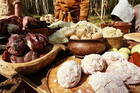 viking cuisine viking rus food being prepared the patties in front are large meatballs filled with a