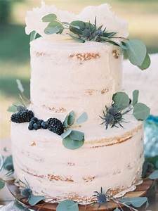Picture Of two tiered cake topped with greenery