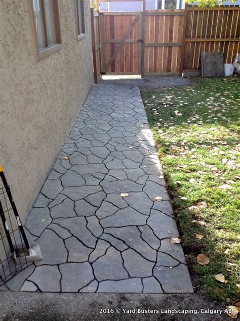 side walkway before and after flagstone walkway along the side of the house yard busters landscaping