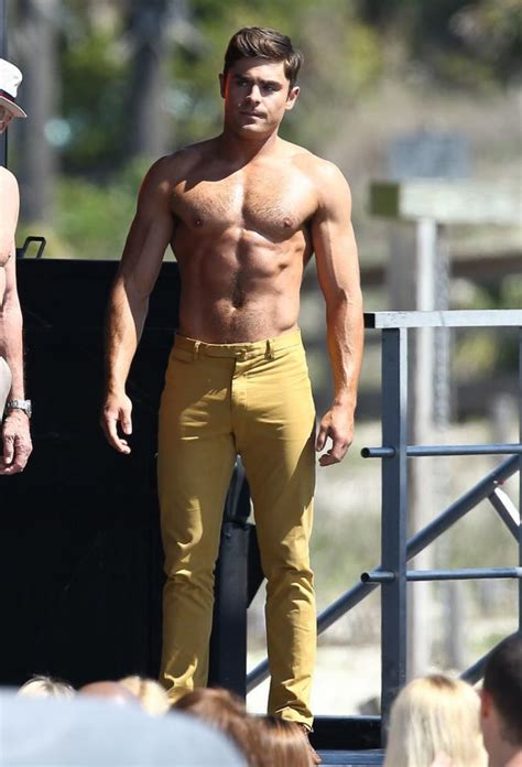 man candy zac efron shows  sign  putting clothes