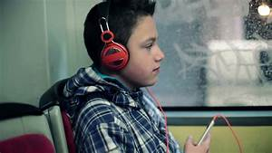 Young Boy Listen To The Music On Smartphone While Riding ...