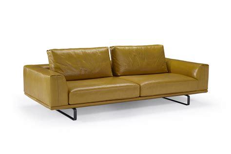 natuzzi italia stuns  stylish sofas dining options