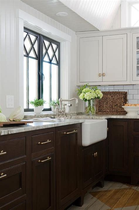 gorgeous kitchen features light grey cabinets and