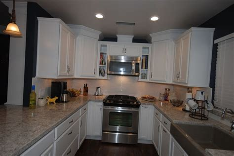 cabin kitchen cabinets starmark white cabinetry with cambria new quay countertops 1904