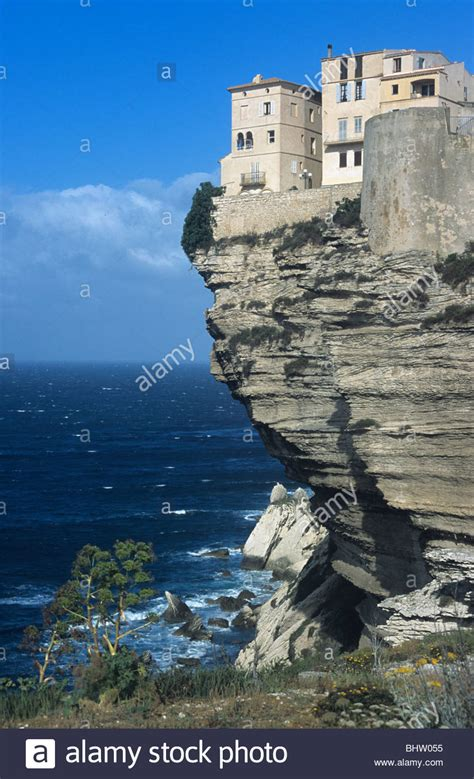 Perched On The Cliff Edge Overlooking The Sea by Clifftop Houses Perched On Edge Of Limestone Cliffs