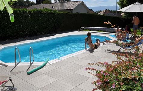 surround your swimming pool with handydeck deck tiles